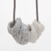 Notions of skill. Necklace 2013. Ready-made marble tableware, velour sticker, steelwire. Stonepart: 11 x 8 x 6 cm, length of the necklace 46 cm.